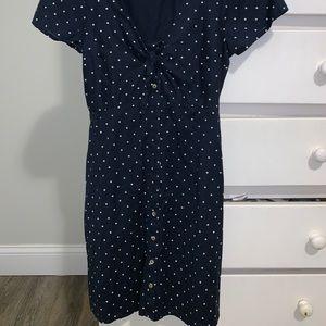 A used, buttoned up, polkadot mini dress